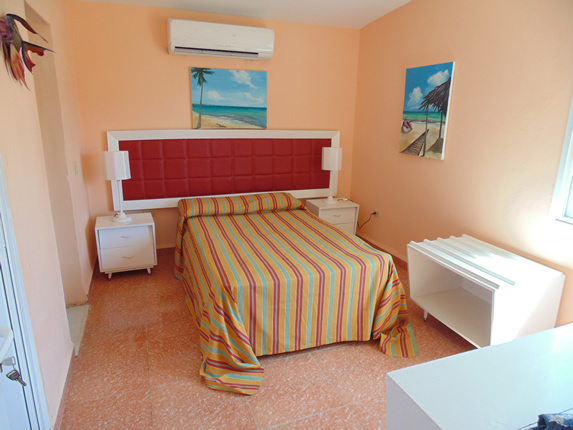 one bed bedroom with white furniture