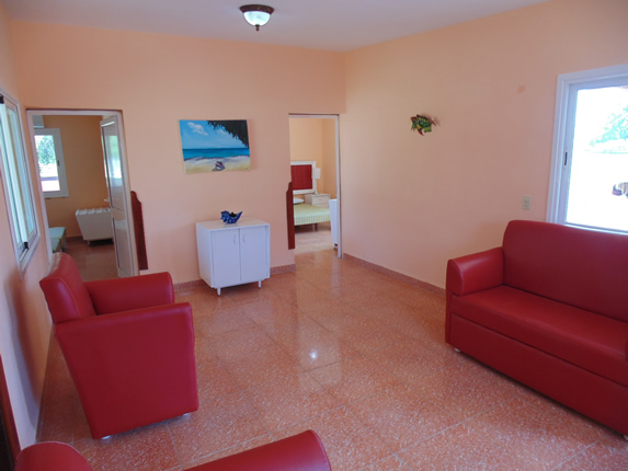 living room with red furniture