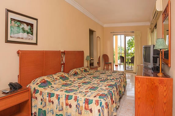 Double room with wooden furniture in the hotel