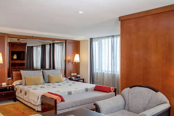 Room with double bed and wooden furniture