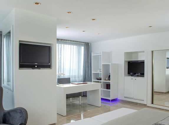 Room with white furniture in the hotel