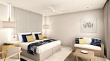 picture of standard room with bed and sofa