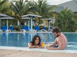 Couple having a drink by pool side