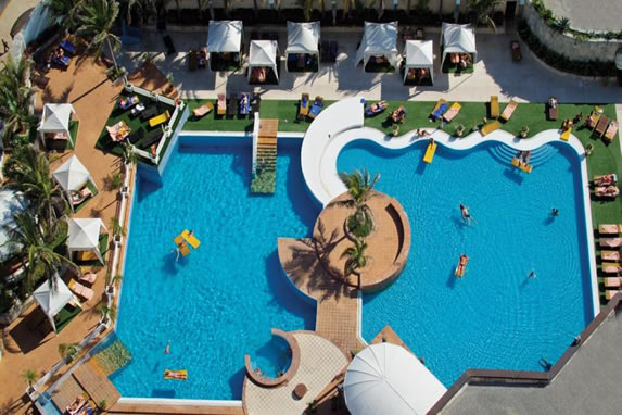 Aerial view of the pool with palm trees in the mid