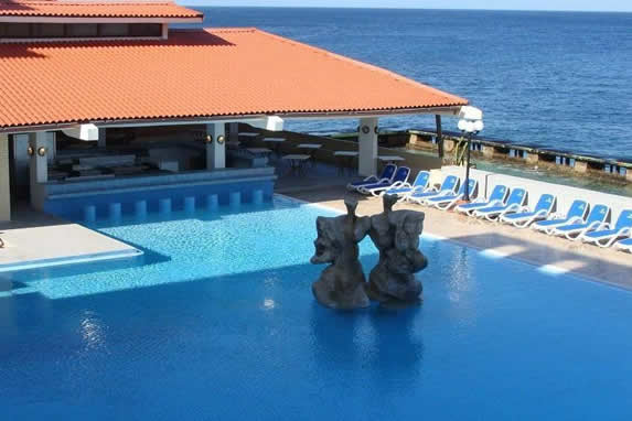 View of hotel pool by the sea