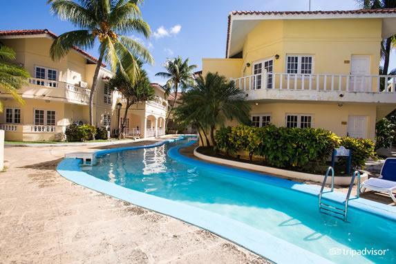 View of pool through bungalows