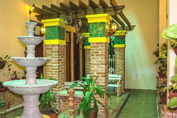 iindoor patio with fountain and plants