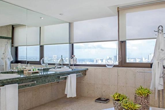 Bathroom with windows overlooking the city