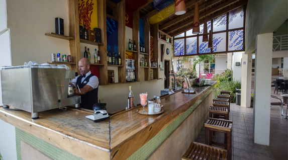 bar with wooden bar and stools