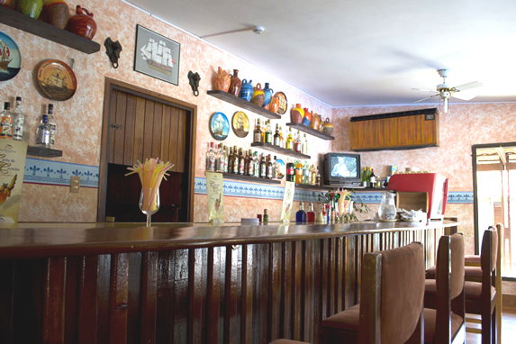 bar with wooden bar and wall with decoration