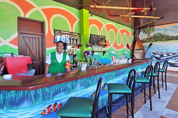 colorful wooden bar under wooden roof