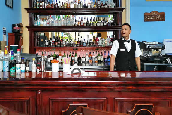 wooden bar with drink bottles