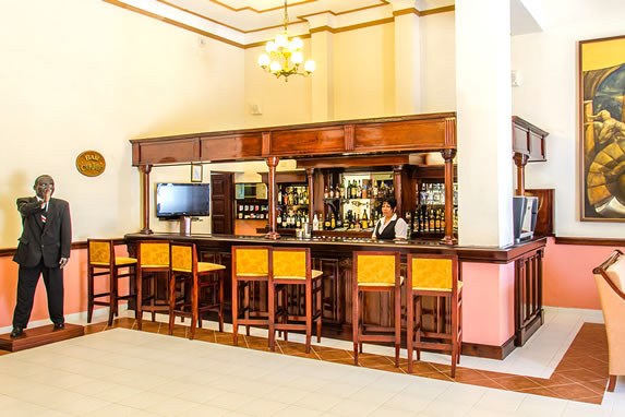 hotel bar with wooden bar and stools