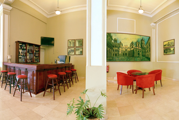 lobby bar with red furniture and wooden bar