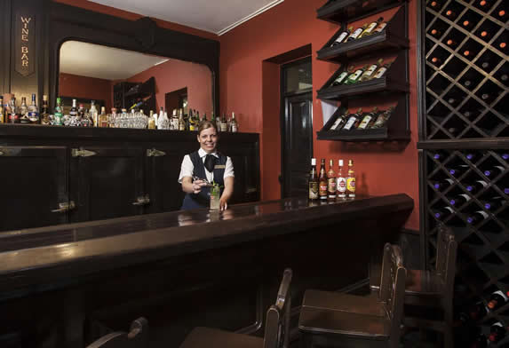 dark wooden bar with stools
