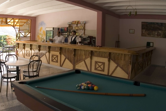 bar with pool table and furniture