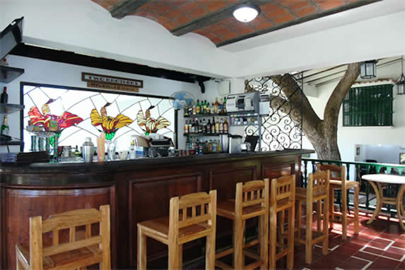 wooden bar and colorful stained glass in the back