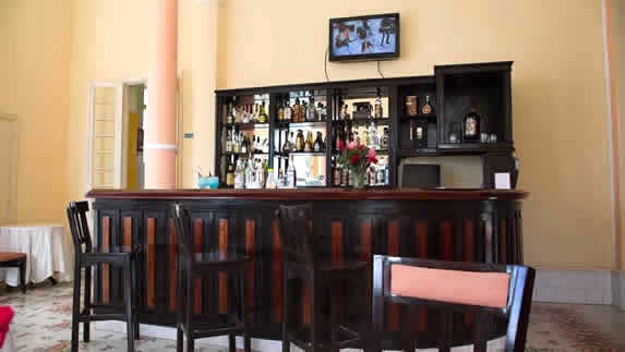 small bar with a wooden bar in the restaurant