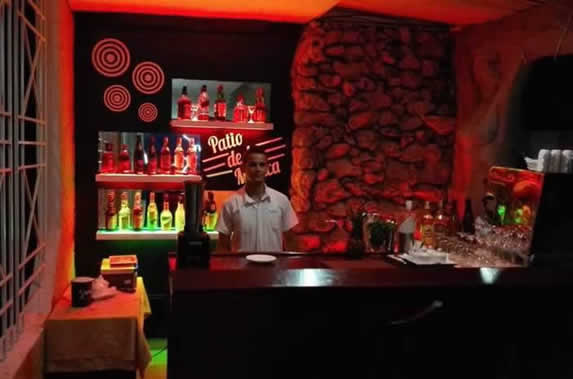 small wooden bar with night lighting