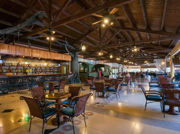 lobby bar with wooden ceiling and furniture