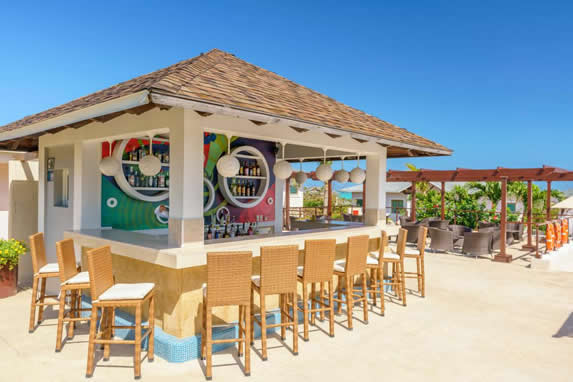 beach snack bar with bar and stools