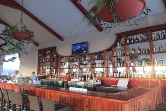 wooden bar and bottles on wooden shelves