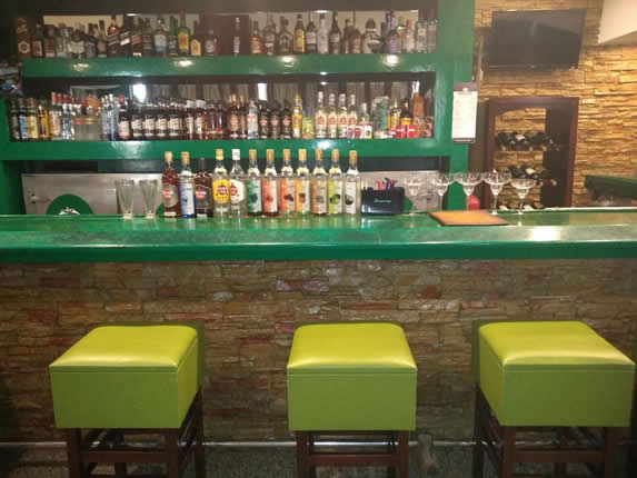 bar with bar and green furniture