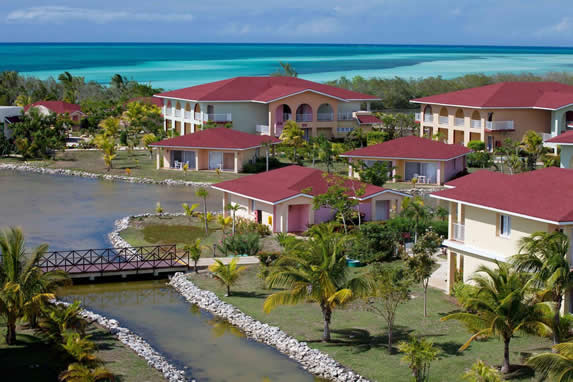 aerial view of bungalows by the sea and the lagoon