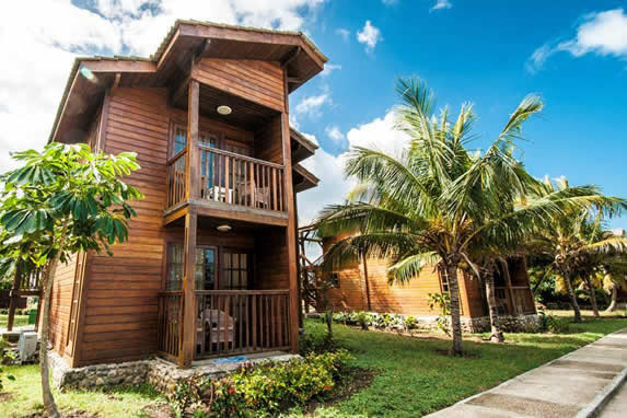 two-story wooden bungalow with balcony