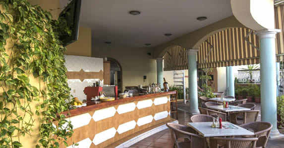 Outdoor cafe with columns and wooden bar