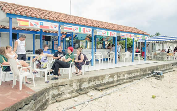 tourists in the beachfront restaurant