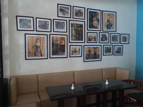 cafeteria with furniture and decorative paintings