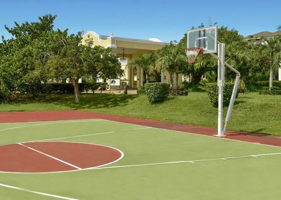 basketball court surrounded by greenery