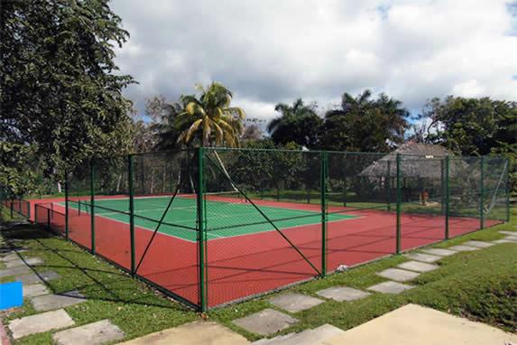 fenced tennis court