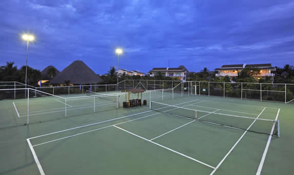 Tennis courts lit at dusk