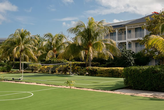 soccer field surrounded by palm trees