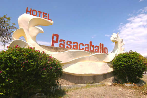 hotel name made of cement with sculpture