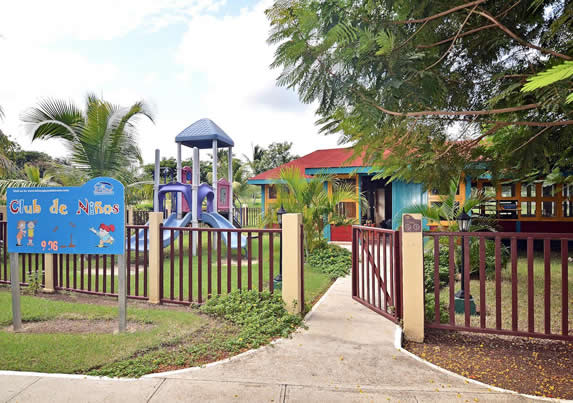 colorful playground with greenery