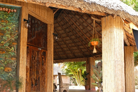 wooden cabin with guano roof and map