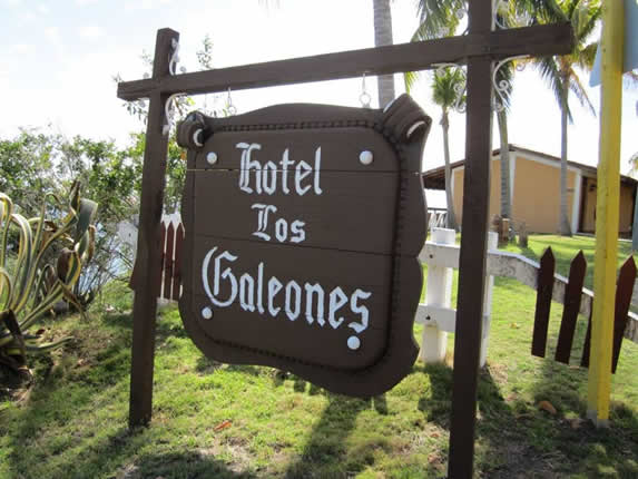 wooden sign at the hotel entrance