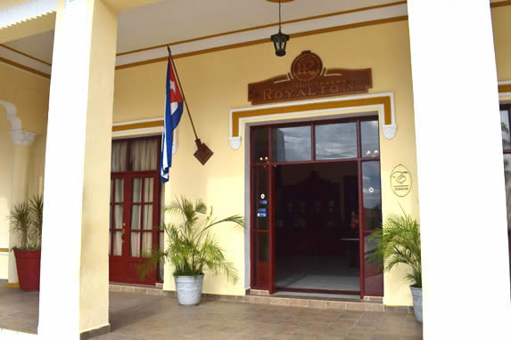 hotel entrance with wooden door and flag