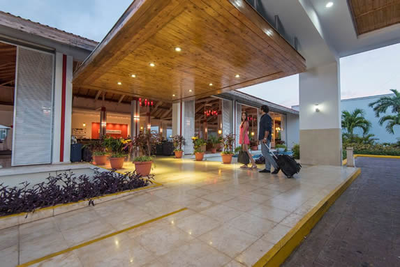 Hotel entrance with wooden ceiling and lights