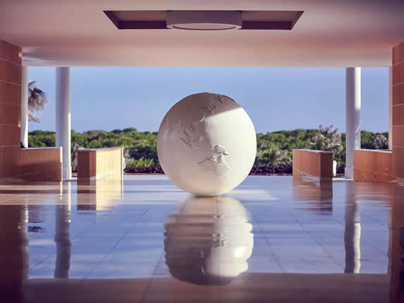 entrance with decorative white world ball