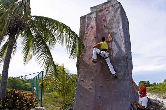 tourist climbing artificial stone