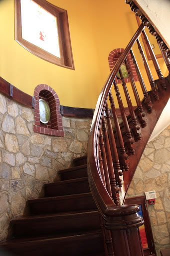 wooden stairs and stone walls