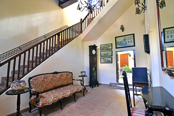 room with antique furniture and wooden stairs