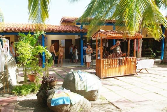 outdoor craft stand under palm tree