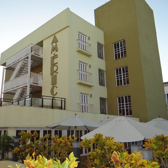 hotel facade with vertical sign