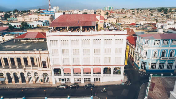 aerial view of the white facade of the hotel