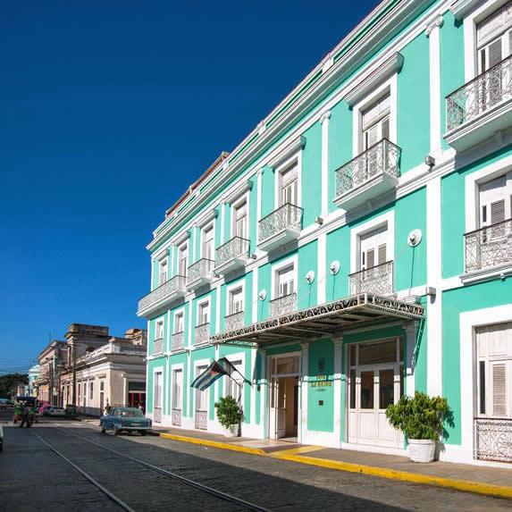 colonial hotel facade under blue sky